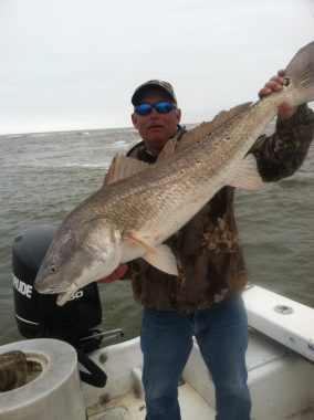 St. George Island Fishing Charters - Woodduck holding Red