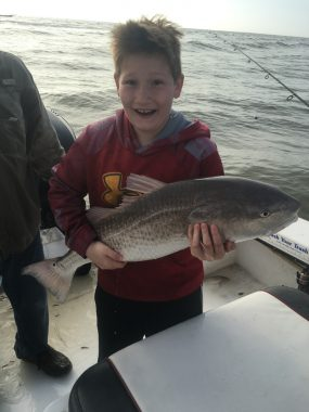 Fishing Guide in St George Island - Young boy excited about catching a redfish