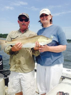 Apalachicola Fishing Guides - Woodduck and client holding huge redfish