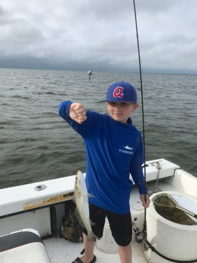 St George Island Fishing Charters - Child with his first catch