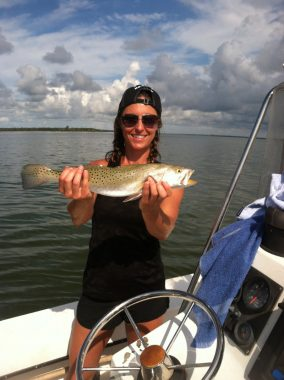 Apalachicola Charter Fishing - Happy Fishing client holding a Trout