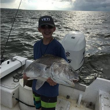 Happy-kid-charter-fishing-on-St-George-Island